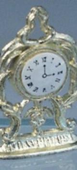 Pendule plate dorée en métal