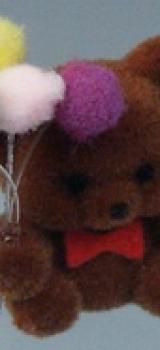 Peluche ours brun avec ballons
